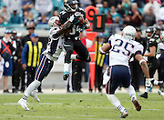 New England Patriots free safety Devin McCourty (32) breaks up a pass play to leaping Jacksonville Jaguars wide receiver Cecil Shorts III (84) during the NFL week 16 football game against the New England Patriots on Sunday, Dec. 23, 2012 in Jacksonville, Fla. An unnecessary roughness penalty gave the Jags a 15 yard gain and a first down with less than a minute left in the game. The Patriots won the game 23-16. ©Paul Anthony Spinelli