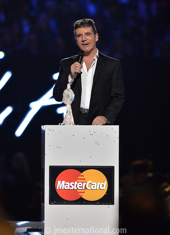 Simon Cowell  on stage at the 2015 BRIT Awards with Mastercard, held at the O2 Arena in London, Wednesday, 25 February, 2015. Photo by John Marshall/JM Enternational