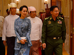 Myanmar's Commander-in-Chief of the armed forces Senior-General Min Aung Hlaing (R, front) and chairperson of Myanmar's ruling National League for Democracy (NLD) Aung San Suu Kyi (L, front) arrive to attend the president power handover ceremony at the Presidential Palace in Nay Pyi Taw, Myanmar, March 30, 2016. Myanmar's new President U Htin Kyaw pledged on Wednesday to implement four policies based on the policies of the ruling NLD, led by Aung San Suu Kyi. EXPA Pictures © 2016, PhotoCredit: EXPA/ Photoshot/ MOI<br /> <br /> *****ATTENTION - for AUT, SLO, CRO, SRB, BIH, MAZ, SUI only*****