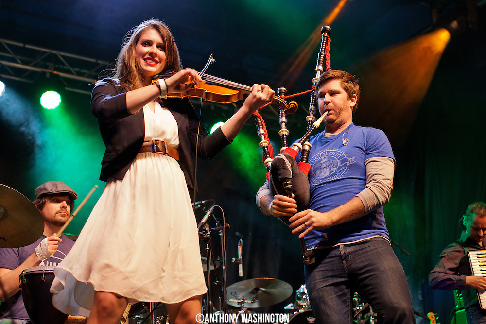 Kiana Weber and Peter Purvis of the band Gaelic Storm perform during Shamrockfest on the grounds of RFK Stadium in Washington, DC on Saturday, March 21, 2015.