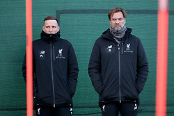 Liverpool manager Jurgen Klopp (right) and Assistant manager Pep Lijnders watch over the players during the training session at Melwood training ground, Liverpool.