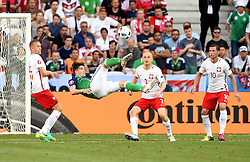 Kyle Lafferty of Northern Ireland attempt an over head kick  - Mandatory by-line: Joe Meredith/JMP - 12/06/2016 - FOOTBALL - Stade de Nice - Nice, France - Poland v Northern Ireland - UEFA European Championship Group C