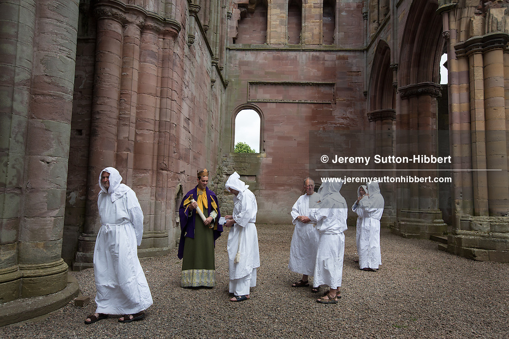 A stop during The Tour Of Ceremonies at Melrose Abbey, with local people dressed as monks and Kind David, and with Melrosian Sam Thomson and Festival Queen Zoe Palmer, and their courts, laying a wreath over the spot which some believes marks the location of the heart of Robert The Bruce, during the Melrose Festival, near Melrose, Scotland, Saturday 22nd June 2013.<br /> N55&deg;35.954'<br /> W2&deg;43.076'