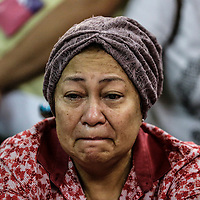 A family members of crashed Malaysia Airlines flight weep at Kuala Lumpur International Airport (KLIA) in Sepang outside Kuala Lumpur, Malaysia, 18 May 2014. Malaysia Airlines lost contact with Flight MH17 at 5:15 pm (1415 GMT), about 50 kilometres from the Russia-Ukraine border, the airline said in a statement. The Boeing 777 departed Amsterdam at 12:15 pm and was scheduled to arrive in Kuala Lumpur at 6:10 am 18 July. The plane was carrying 280 passengers and 15 crew members, the statement said.