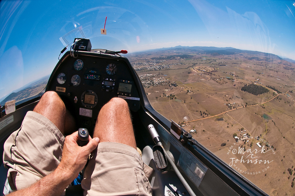 Glider pilot with hand on control stick, Boonah, Queensland, Australia