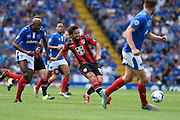 Laurence Wilson threads a through ball during the Sky Bet League 2 match between Portsmouth and Morecambe at Fratton Park, Portsmouth, England on 22 August 2015. Photo by David Charbit.