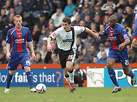 Photo: Leigh Quinnell.<br /> Derby County v Crystal Palace. Coca Cola Championship. 25/03/2006. Derbys Adam Bolder breaks away from Palaces'  Emmerson Boyce.