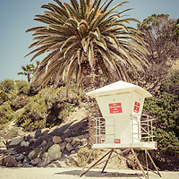 Laguna Beach California lifeguard tower retro picture with palm trees and sand. Laguna Beach is a beach community along the Pacific Ocean in Orange County Southern California.
