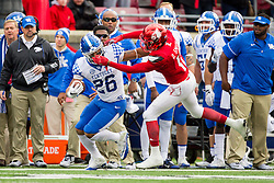 Louisville safety Dee Smith, right is called for a face mask while pursuing Kentucky running back Benny Snell Jr., in the first quarter. The University of Louisville hosted Kentucky, Saturday, Nov. 26, 2016 at Papa John's Cardinal Stadium in Louisville. Kentucky won the game 41-38.
