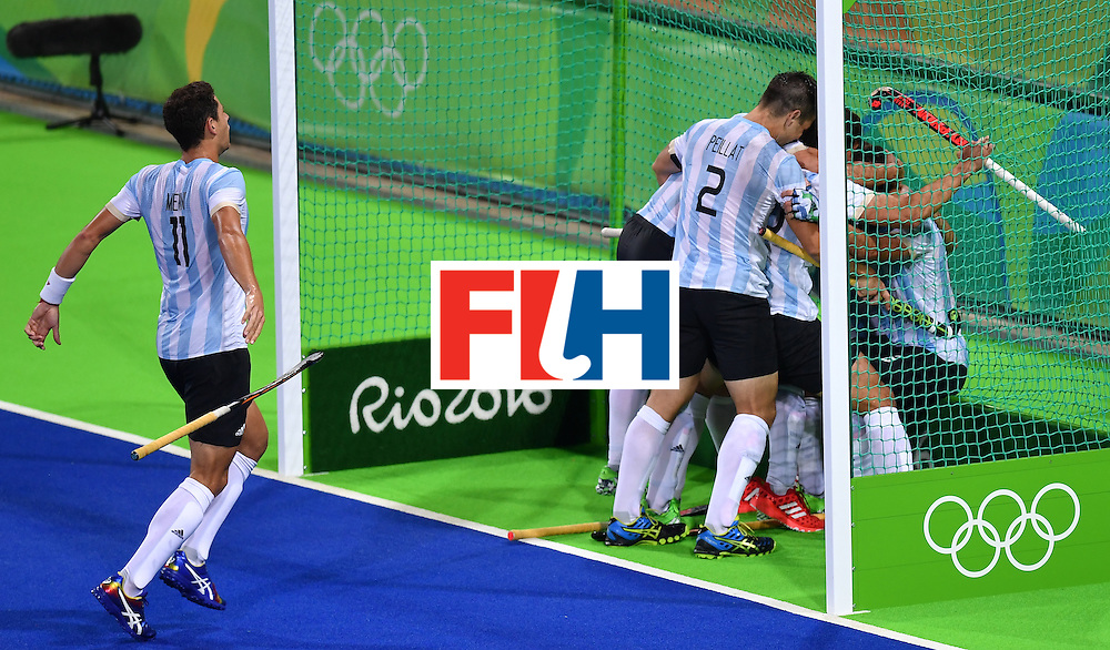 Argentina's players celebrate their fourth goal during the men's Gold medal field hockey Belgium vs Argentina match of the Rio 2016 Olympics Games at the Olympic Hockey Centre in Rio de Janeiro on August 18, 2016. / AFP / MANAN VATSYAYANA        (Photo credit should read MANAN VATSYAYANA/AFP/Getty Images)