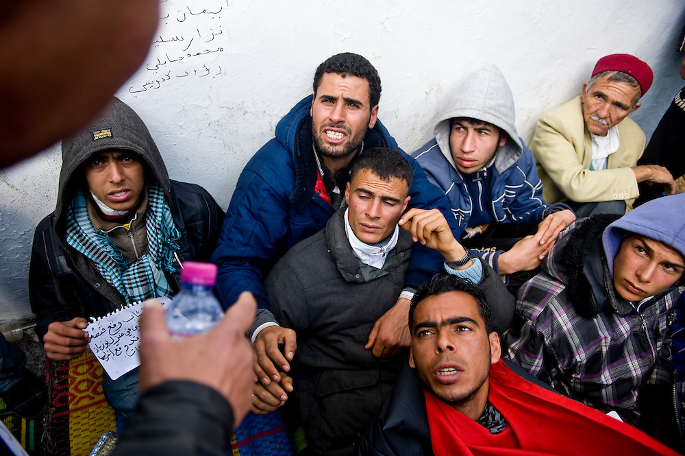 "Protesters of the 'Caravan of Freedom' continue their sit-in on the Kasbah square in Tunis, Tunisia on January 24, 2011. Protesters said they will continue their sit-in until the fall of the interim Government and satisfaction of their demands for decent life. Copyright Benjamin Girette /// On january the 14th 2011, Zine el-Abidine Ben Ali President of Tunisia and his famous wife Leila Trabelsi as know as ""The regent of Carthage"" are forced by thousands of protesters to escape the country after 24 years of power. As a result a new democraty is in design for the next six months until Tunisians organize national democratic elections, it might be the birth of the first democraty in the arab world.."