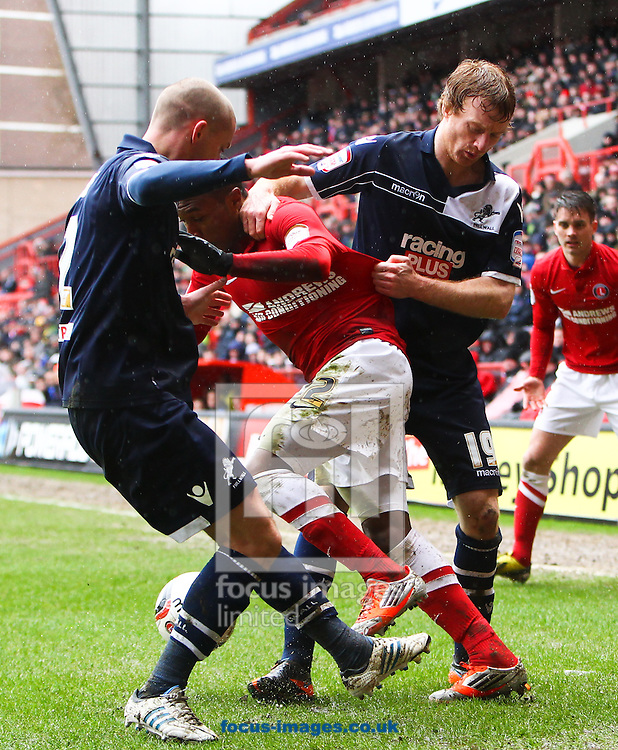 Picture by John  Rainford/Focus Images Ltd +44 7506 538356.16/03/2013.Callum Herriott of Charlton Athletic tries to get between Alan Dunne and Chris Taylor of Millwall during the npower Championship match at The Valley, London.