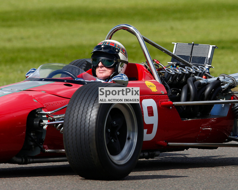 GOODWOOD REVIVAL.....Sir Jackie Stewart in a demonstration drive F1 McLaren which was driven by the late Bruce McLaren ..(c) STEPHEN LAWSON | SportPix.org.uk