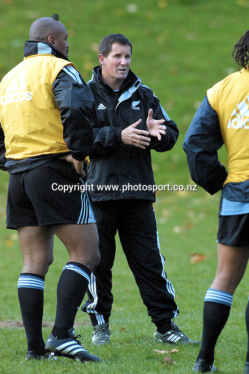 Assistant coach Robie Deans talks to Jonah Lomu during an All Black training session during their tour of Argentina, Buenos Aires, 2001. Photo: Chris Skelton/PHOTOSPORT<br /><br /><br /><br />046055 *** Local Caption ***