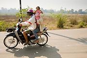 25 FEBRUARY 2008 -- MAE SOT, TAK, THAILAND: A Thai family rides their motorcycle on a highway near Mae Sot, Thailand.   Photo by Jack Kurtz