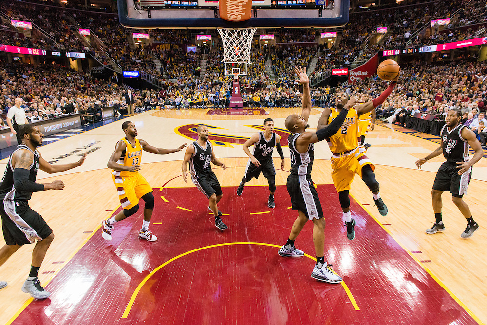 CLEVELAND, OH - JANUARY 30: Kyrie Irving #2 of the Cleveland Cavaliers shoots over David West #30 of the San Antonio Spurs during the third quarter at Quicken Loans Arena on January 30, 2016 in Cleveland, Ohio. The Cavaliers defeated the Spurs 117-103. NOTE TO USER: User expressly acknowledges and agrees that, by downloading and/or using this photograph, user is consenting to the terms and conditions of the Getty Images License Agreement. Mandatory copyright notice. (Photo by Jason Miller/Getty Images) *** Local Caption ***Kyrie Irving;