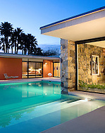 Photo of mid century modern home and pool in Rancho Mirage, Coachella Valley, CA. Shot at dusk