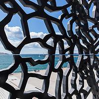 France, Marseilles, View of Mediterranean Sea coastline through metallic exterior Museum of European and Mediterranean Civilizations on waterfront