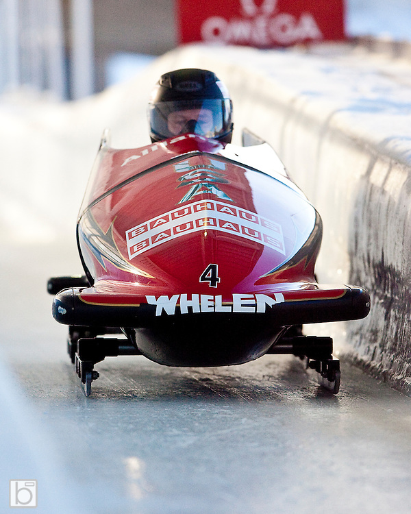 """USA 2 sled driven by Steven Holcomb and brakeman Curtis Tomasevicz slide through the """"chicane"""" during the second run of the two-man Bobsled World Championships at the Olympic Sports Complex in Lake Placid, N.Y. Saturday, Feb 21, 2009.  (Photo/Todd Bissonette - usabobsledphotos.com)"""