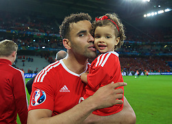 LILLE, FRANCE - Friday, July 1, 2016: Wales' Hal Robson-Kanu celebrates with his daughter after a 3-1 victory over Belgium and reaching the Semi-Final during the UEFA Euro 2016 Championship Quarter-Final match at the Stade Pierre Mauroy. (Pic by David Rawcliffe/Propaganda)