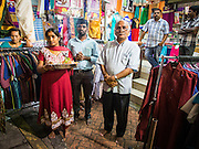 04 OCTOBER 2014 - GEORGE TOWN, PENANG, MALAYSIA: People wait to make an offering as a procession honoring Durga is drawn through the streets of George Town during the Navratri procession. Navratri is a festival dedicated to the worship of the Hindu deity Durga, the most popular incarnation of Devi and one of the main forms of the Goddess Shakti in the Hindu pantheon. The word Navaratri means 'nine nights' in Sanskrit, nava meaning nine and ratri meaning nights. During these nine nights and ten days, nine forms of Shakti/Devi are worshiped.   PHOTO BY JACK KURTZ