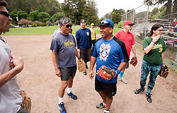 Players share a laugh as the Montclair softball league celebrates its 50th season, Saturday, April 22, 2017, at Montclair Park in Oakland, Calif. The pickup softball game, played every Saturday by a group of enthusiasts ranging in age from 20 to 75, started in 1968 in Berkeley and moved to Montclair about 25 years ago. (Photo by D. Ross Cameron)