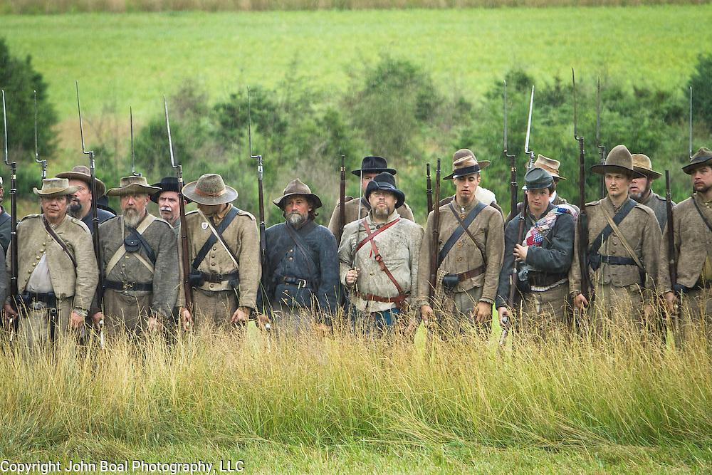 Confederate living historians line up during an artillery and skirmish demonstration, during the Sesquicentennial Anniversary of the Battle of Gettysburg, Pennsylvania on Wednesday, July 3, 2013.  The Battle of Gettysburg lasted from July 1-3, 1863 resulting in over 50,000 soldiers killed, wounded or missing.  John Boal Photography