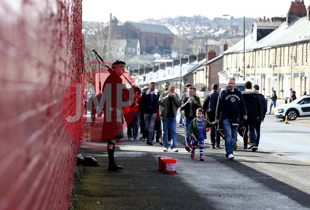 Sheffield Wednesday fans arrive at Barnsley while a bagpiper plays - Mandatory by-line: Robbie Stephenson/JMP - 01/04/2017 - FOOTBALL - Oakwell Stadium - Barnsley, England - Barnsley v Sheffield Wednesday - Sky Bet Championship