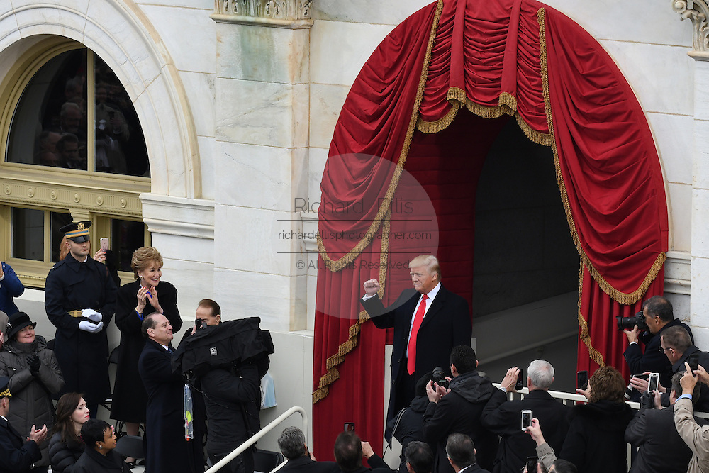 President-elect Donald Trump holds up his fist after arriving for the Inaugural Ceremony to become the 45th President on Capitol Hill January 20, 2017 in Washington, DC.