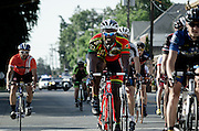Cyclists in the 3rd Annual Uptown Pitman Bob Riccio Memorial Bike Race.