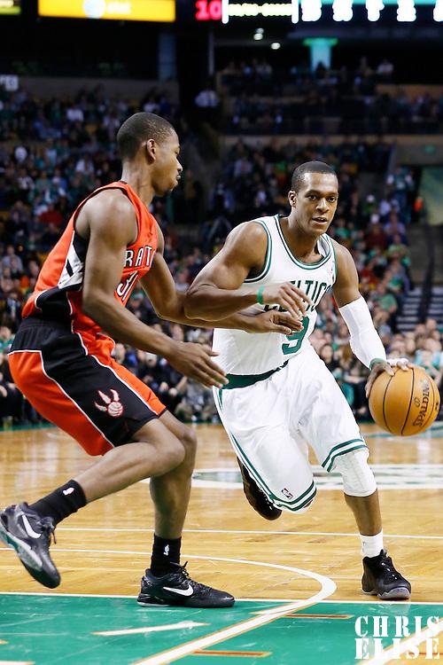 17 November 2012: Boston Celtics point guard Rajon Rondo (9) drives past Toronto Raptors shooting guard Terrence Ross (31) during the Boston Celtics 107-89 victory over the Toronto Raptors at the TD Garden, Boston, Massachusetts, USA.