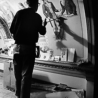 Capitol muralist Cliff Young paints details in his rendering of the 1789 Inauguration of George Washington on the ceiling of the Great Experiment Hall in the U.S. Capitol Building while standing on a scaffolding.