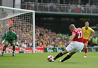 Photo: Lee Earle.<br /> Watford v Manchester United. The Barclays Premiership. 26/08/2006.United's Mikael Silvestre (r) slots home their opening goal.