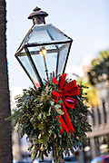 Gas street lamp decorated for Christmas in Charleston, South Carolina.
