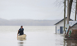 A man uses a canoe to move along the Hudson-Oka ferry loading ramp in the town of Hudson, Quebec, Canada., west of Montreal, Monday, May 8, 2017, following flooding in the region. Photo by Graham Hughes /The Canadian Press/ABACAPRESS.COM