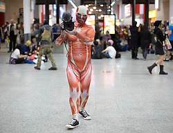 © Licensed to London News Pictures. 24/10/2015. London, UK. A cosplayer dressed in a muscle skin suit at the MCM London Comic Con in London ExCeL on Saturday October 24th. Photo credit : Isabel Infantes/LNP