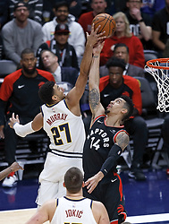 December 16, 2018 - Denver, Colorado, U.S - Nuggets JAMAL MURRAY, left, goes to the basket with Raptors DANNY GREEN, right, during the 2nd. Half at the Pepsi Center Sunday evening. The Nuggets beat the Raptors 95-86. (Credit Image: © Hector Acevedo/ZUMA Wire)