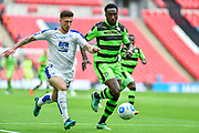 Tranmere Rovers Cole Stockton(23) and Forest Green Rovers Manny Monthe(3) challenge for the ball during the Vanarama National League Play Off Final match between Tranmere Rovers and Forest Green Rovers at Wembley Stadium, London, England on 14 May 2017. Photo by Adam Rivers.