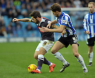 xSam Hutchinson of Sheffield Wednesday challanges Jacob Butterfield of Derby County during the Sky Bet Championship match at Hillsborough, Sheffield<br /> Picture by Graham Crowther/Focus Images Ltd +44 7763 140036<br /> 06/12/2015