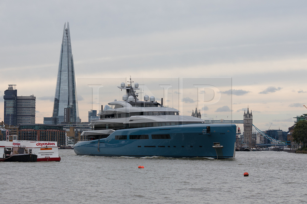 © Licensed to London News Pictures. 12/09/2018. London, UK.  Billionaire Spurs owner, Joe Lewis's 321 feet long luxury superyacht Aviva leaves London passing the Shard and Tower Bridge on the River Thames following a London visit. Aviva, worth an estimated £113m is one of a growing number of superyachts to visit the capital this year and moored near Butlers Wharf for a number of weeks, during which wealthy homeowners criticised the Spurs owner for spoiling their river view.  Photo credit: Vickie Flores/LNP