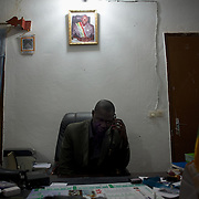 January 19, 2013 - Niono, Mali: Moriba Coulibaly, the Major of Niono village, receives a call from people sieged in the neighbouring cry of Diabaly. Niono is the last government controlled location before Diabaly, a city under islamist militants control since the 14th of January. In the back<br />