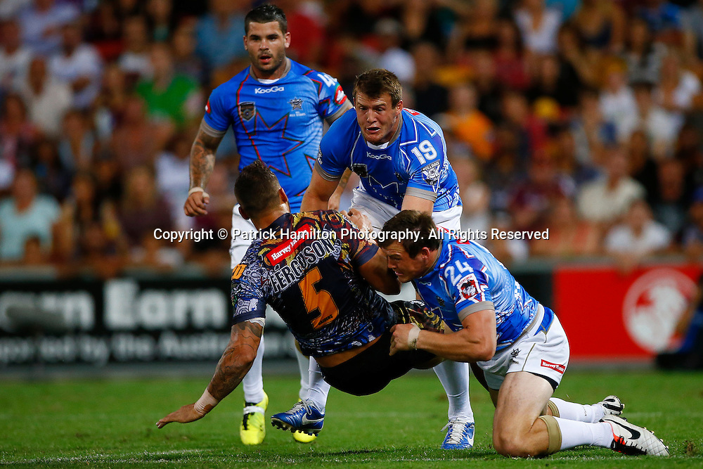 Blake Ferguson is tackled by Kieran Foran (l) and Justin O'Neill (r) during the NRL All Stars game at Suncorp Stadium, Brisbane on February 09, 2013.