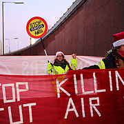 The activist group Stop Killing Londoners block access roads out of Chiswick Roundabout, December 18th 2017, London, UK.  The action is part of a long running campaign to curb air pollution in London.