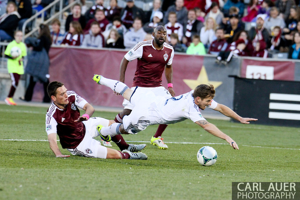 October 19th, 2013:  Vancouver Whitecaps FC defender Jordan Harvey (2) is fouled in the box by Colorado Rapids midfielder Shane O'Neill (27) which would lead to a penalty kick for Vancouver in the second half of the MLS Soccer Match between the Vancouver Whitecaps FC and the Colorado Rapids at Dick's Sporting Goods Park in Commerce City, Colorado