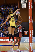 Tactix's Mwai Kumwenda (R takes a shot at goal with Pulse's Phoenix Karaka during the ANZ Champs Pulse vs Tactix netball match at TSB Arena in Wellington on Sunday the 01 May 2016. Copyright Photo by Marty Melville / www.Photosport.nz