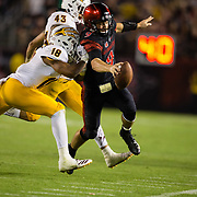 15 September 2018: San Diego State Aztecs quarterback Ryan Agnew (9) stretches for the first down marker in the fourth quarter with the Aztecs leading 20-14. The Aztecs beat the Sun Devils 28-21 at SDCCU Stadium in San Diego, California.