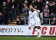 Gylfi Sigurdsson of Swansea City celebrates his teams first goal with Modou Barrow during the Premier League match between Swansea City and Crystal Palace at the Liberty Stadium, Swansea, Wales on 26 November 2016. Photo by Andrew Lewis.