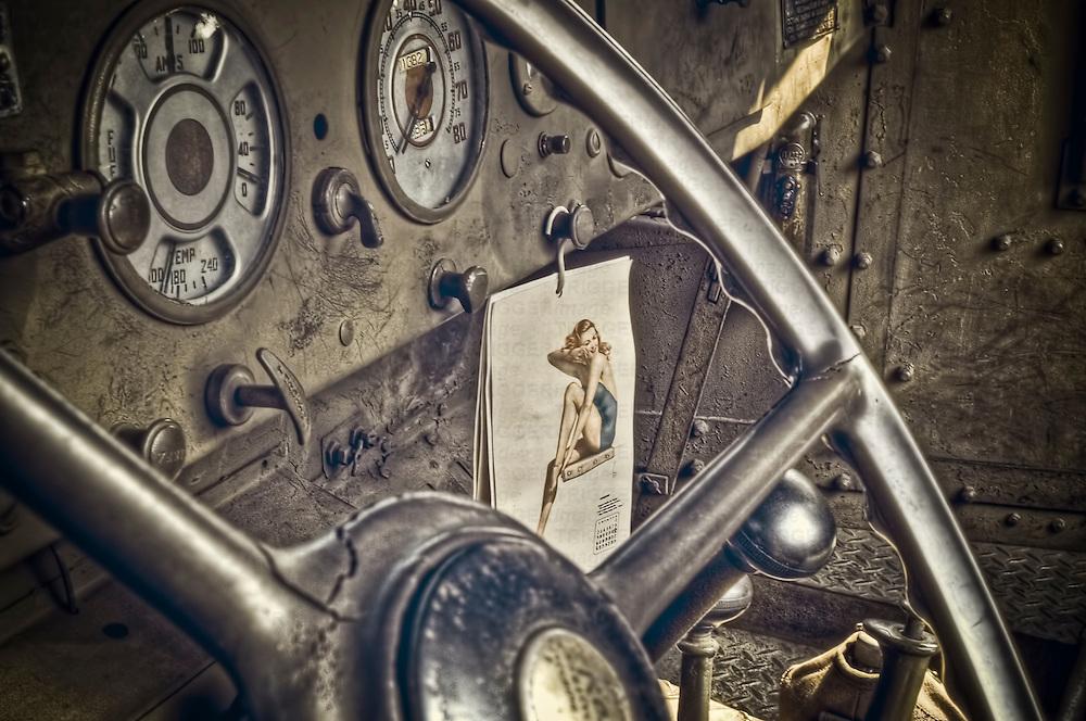 World War II truck interior shows a GI's pin up girl calendar.