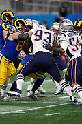 New England Patriots defensive tackle Lawrence Guy (93) tackles Los Angeles Rams running back C.J. Anderson (35) in a pile of players despite a block by Rams offensive guard Austin Blythe (66) during the NFL Super Bowl 53 football game on Sunday, Feb. 3, 2019, in Atlanta. The Patriots defeated the Rams 13-3. (©Paul Anthony Spinelli)