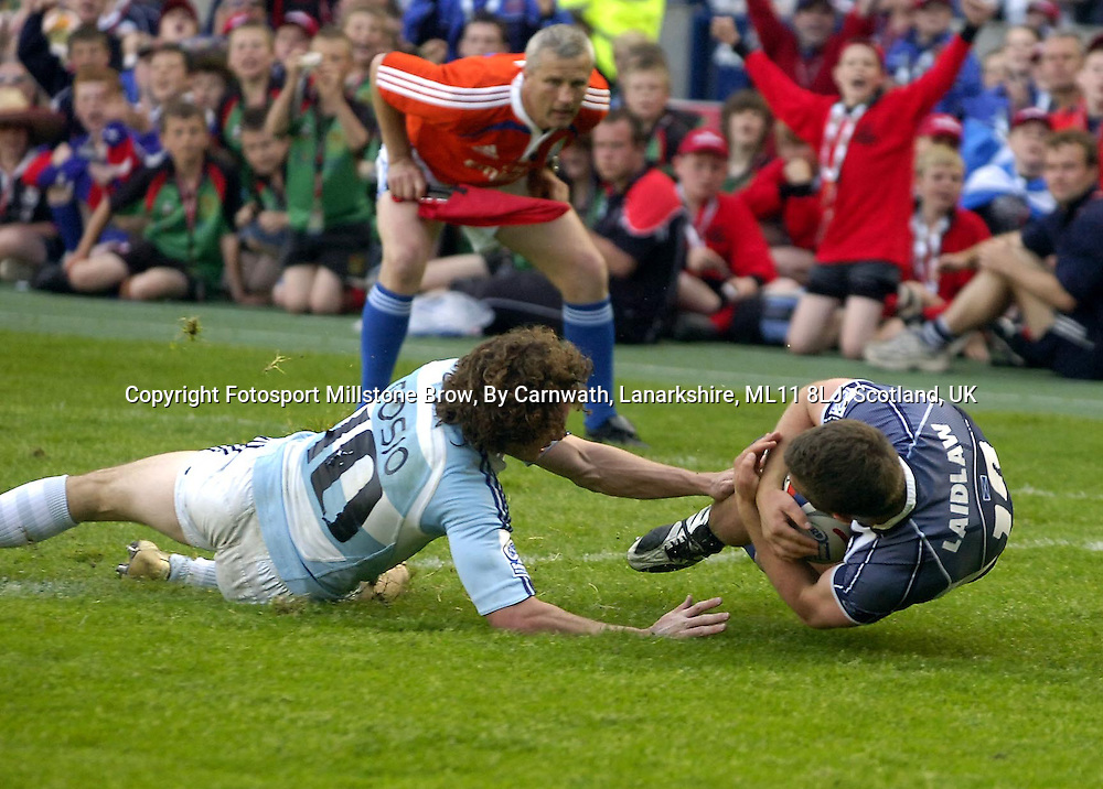 Scotland's Greig Laidlaw beats the tackle of Agustin Gosio to score a scond half try<br /> Scotland v Argentina, IRB Edinburgh Sevens, Murrayfield Stadium, Edinburgh, Day 1, Saturday 31st June 2008